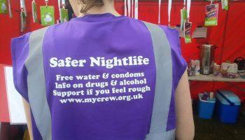 Crew worker wearing a Safer Nightlife bib